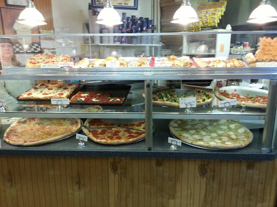 Mario's Pizza and Italian Eatery: Some of the pizza sold by the slice or whole pizza