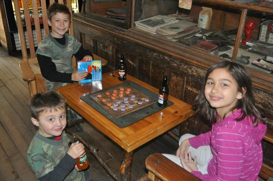 Mast General Store : Drinking root beer and playing checkers
