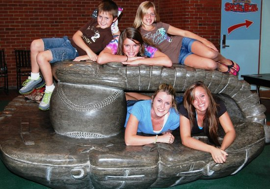 Louisville Slugger Museum & Factory: My crew on the glove sculpture that is available for photo opps outside of the restroom doors.
