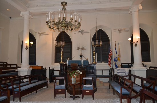 St. Thomas Synagogue : Note the chandelier above and the 11th century Moroccan menorah on the wall.