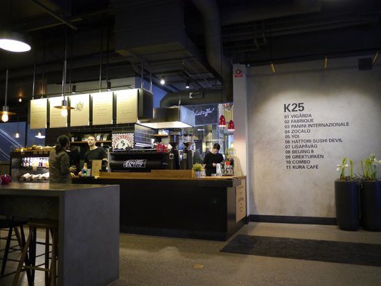 Kura Cafe counter and overview of places in K25