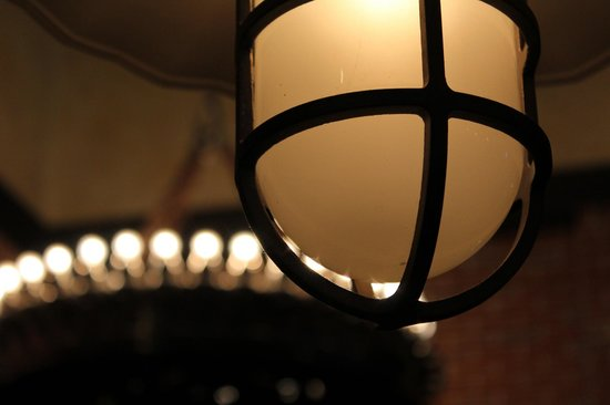 Frankenmuth Brewery: The light above our table with the Chandelier in the background