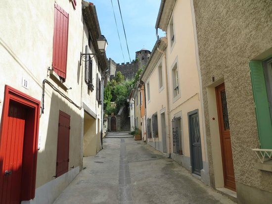 Les Palmiers De La Cite: A village street walking toward the castle. There are others you can take also that are busier.