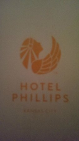 Hotel Phillips: Logo, which is taken from the art deco statue gracing the lobby