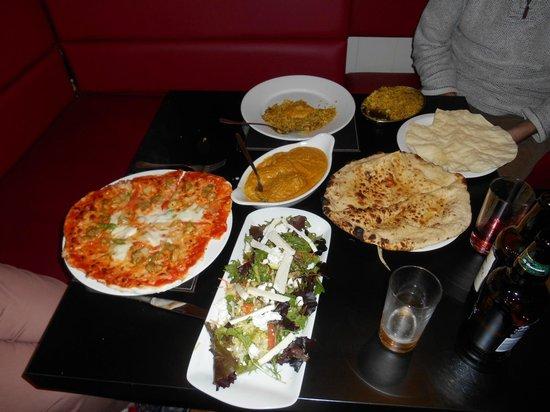 New Delhi Indian Palace Ricardo's Pizza: lamb korma with naan, chicken satay pizza with salad