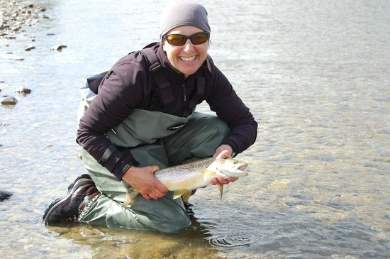 New Zealand Guided Fly Fishing - Tours: Happy client with her first brown trout caught fly fishing
