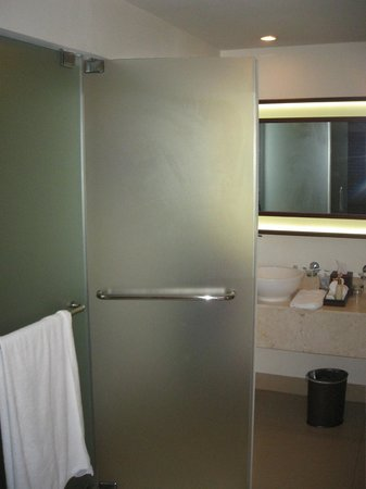 Secrets St. James Montego Bay : Toilet behind a glass door--small area and no wall to separate bahtroom from bedroom--bad design