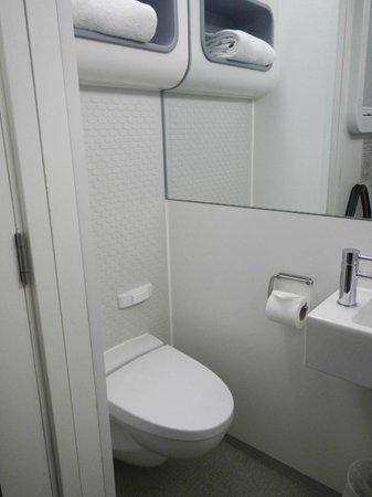 YOTELAIR London Heathrow Airport: Toilet, towel shelf, left side of sink