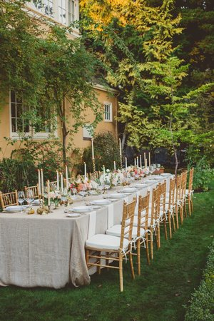 Villa Marco Polo  Inn: Table set for al fresco wedding dinner