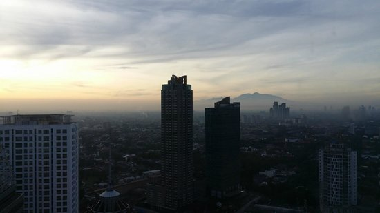 HARRIS Suites FX Sudirman: sunset from room