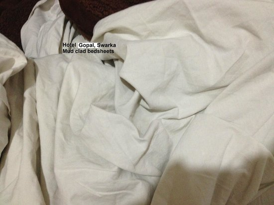 Hotel Gopal: White bedsheets have turned yellow have marks all over