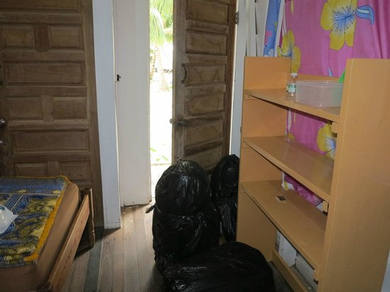 Tobacco Caye Paradise: Cabin with bags covered for the rain
