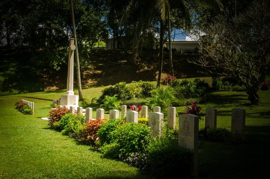 Commonwealth War Cemetery: Row of well maintained graves of the fallen in combat