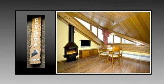 Hotel Roca : Salón con chimenea de uno de los apartamentos del Hotel