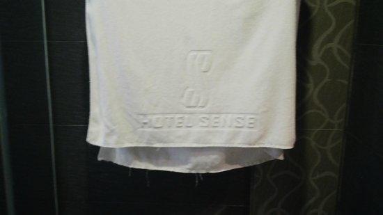 Hotel Sense: torn bathroom towel