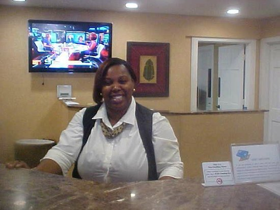 Park Lane Hotel and Suites: The Smiling face of Miss Shwondar Fieds Front Desk