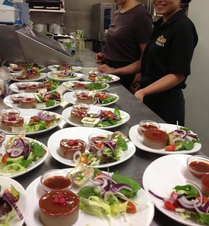 Gayton, UK: Preparing starters in the kitchen.