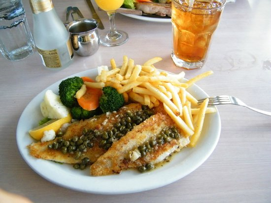 Dolphin Restaurant: very poor and oily fish, with a grizzly steak, um.. the iced tea was good