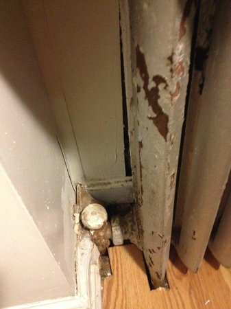 West 46th Street Apartment : painting (dangerous lead?) peeling off from heater