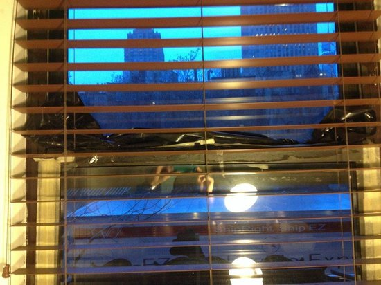 West 46th Street Apartment: window gap filled in with plastic