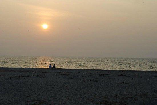 Casamaria Beach Resort: Sunset from beach behind the hotel