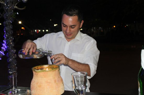 El Cafetal Galapagos: Albert Serving up a shot of Ecuadorian Liquor