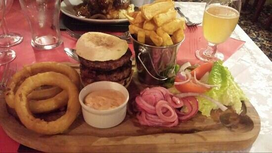 The Boars Head: Lamb & Mint Burger with homemade onion rings, chips and side salad