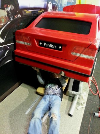 Discovery Place Kids-Huntersville : swapping out a rusty exhaust (foam with Velcro)