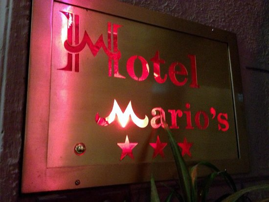Hotel Mario's: Unassuming placard out front on street level