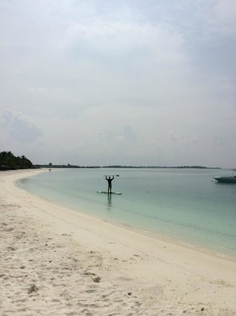 Four Seasons Resort Maldives at Kuda Huraa: Our surf instructor taught us to paddle board in the tranquil lagoon