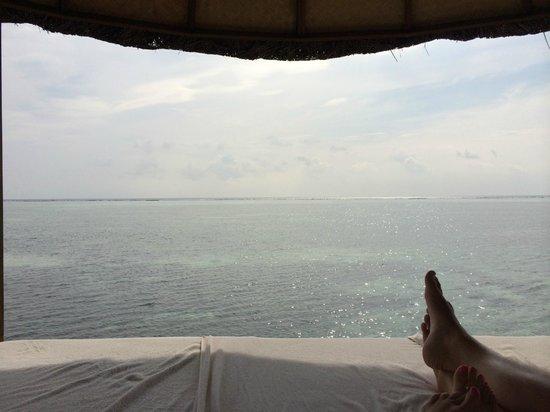 Four Seasons Resort Maldives at Kuda Huraa: View from under a palapa/sala at the family pool