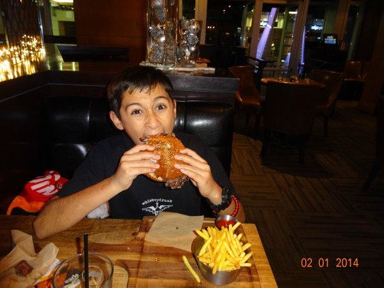 Earls Calgary Downtown : Cheese burger and a kid.