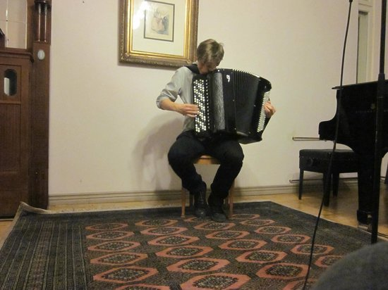 Chopin Boutique B&B: Accordion player - in the music room