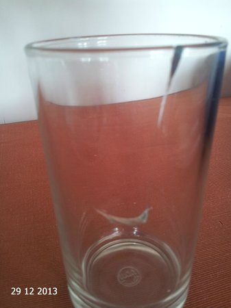 Treebo Vatika Inn: Broken drinking glass kept on table during breakfast