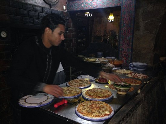 Cafe-Restaurant des Dunes: Making pizza to go in the wood fired oven