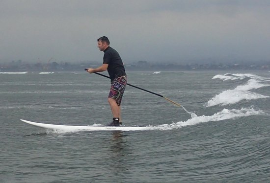 Bali Stand Up Paddle School: catching waves. swell was about half a metre which was perfect for beginners