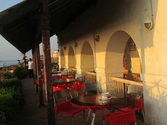 golden light of rising sun in sea facing varandah of le cafe