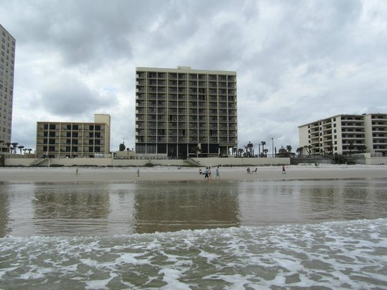 Holiday Inn Express and Suites Oceanfront: View of hotel (larger building) from beach during low tide