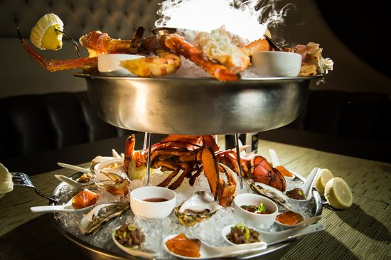 Rush Seafood Tower: shrimp, tuna poke, oysters, dungeness & king crab, smoked salmon, lobster ...