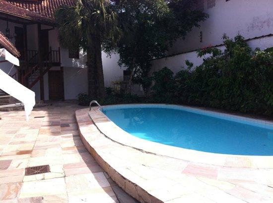 Pousada Valhacouto : Hall de entrada para os apartaentos piscina