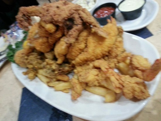Deanie's Seafood: Seafood platter...half size, so you can imagine how much is on the large platter.