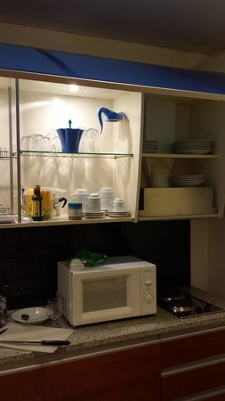 Residence del Mare: Kitchen -- the cups, glasses, water pitcher, etc