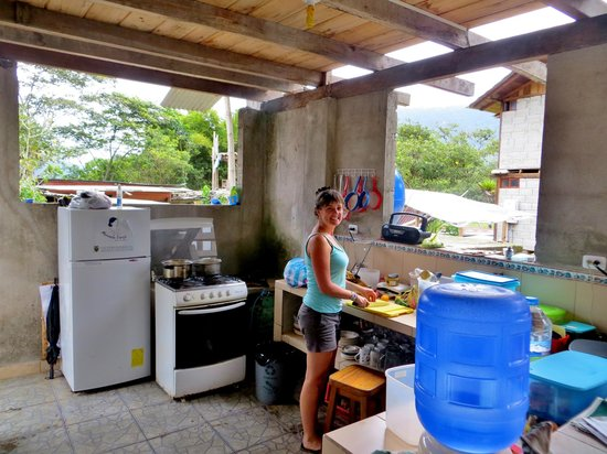 Rubby Hostal: Bec preparing some food.