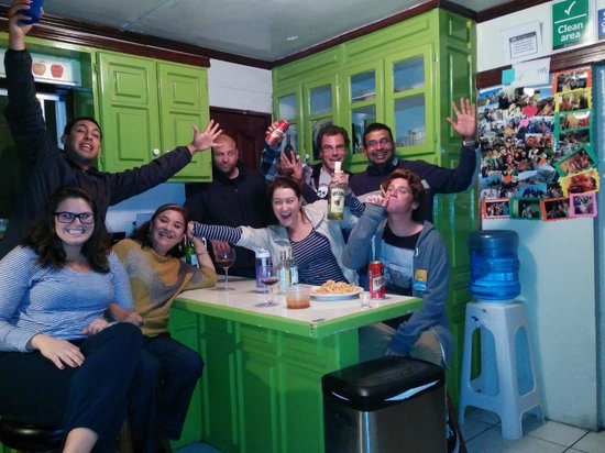 Ensenada Backpacker: New Years Eve 2013 crew having a few drinks in hostel kitchen