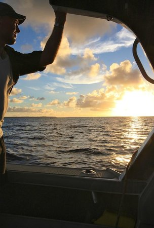 Slice of Heaven Charters: Watching the sunrise on deep water