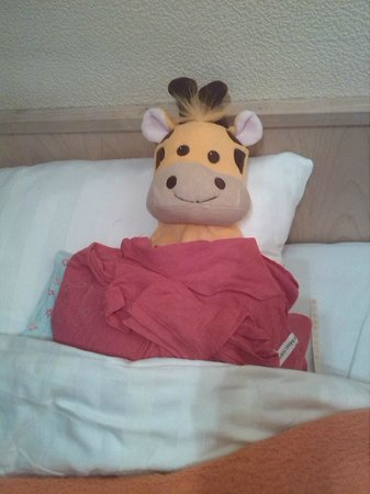 Hotel Atlanta: Meet Gill the Giraffe,essentail for our cold room (hot water bottle)