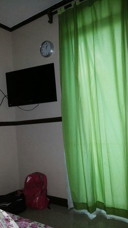 5R Rooms: Their flat screen tv and the door to the veranda