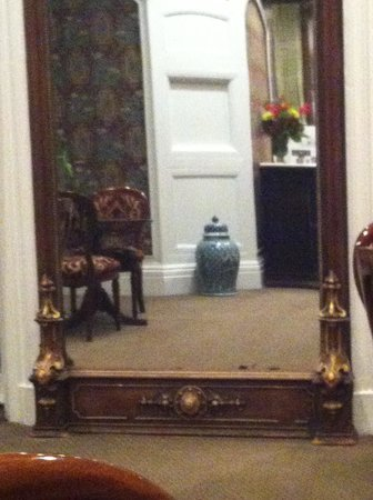 Morrison-Clark Historic Inn & Restaurant: a chinese vase reflected by an antique mirror on the wall