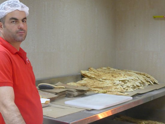 Turkey Central: Baker proudly displaying the bread