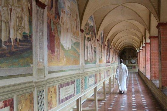 Abbazia di Monte Oliveto Maggiore: A monk walking in the Great Cloister